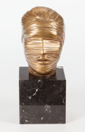 Sculpture, Igor Mitoraj (Polish, 1944-2014). Tête Secrète, 1984. Bronze with gold patina. 4-5/8 inches (11.7cm) high on a 3 inches ... (Total: 2 Items)