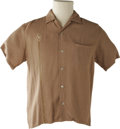 Music Memorabilia:Costumes, Buddy Holly Stage-Worn, Short-Sleeved Shirt. A very nice tan Da Vinci shirt with Lion crest design on right breast worn on ...