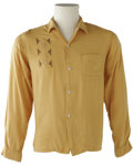 Music Memorabilia:Costumes, Buddy Holly Stage-Worn Gaucho Shirt. A stage-worn, mustard-yellowgaucho shirt owned by Holly, with his initials written on...