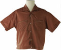 Music Memorabilia:Costumes, Buddy Holly Stage-Worn Van Heusen Shirt. Red-brown short-sleeved Van Heusen shirt with white piping on the breast pockets, ...