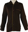 Music Memorabilia:Costumes, Buddy Holly Stage-Worn Brown Shirt. A brown nylon shirt with gold trim owned and worn on stage by Holly. In Excellent Condit...