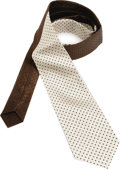 Music Memorabilia:Costumes, Buddy Holly Stage-Worn Necktie. Dark-brown and beige silk necktiewith brown dot pattern, owned and worn on stage by Holly....