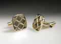 Music Memorabilia:Costumes, Buddy Holly Stage-Worn Cuff Links. This pair of gold metal cufflinks enhanced with a diamond pattern was worn on stage by H...