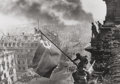 Photographs, Yevgeni Khaldei (Russian, 1917-1997). Raising the Red Flag over the Reichstag, 1945. Gelatin silver, printed later. 11-1...