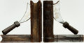 """Books:Furniture & Accessories, [Bookends]. Pair of Matching """"Book and Scimitar"""" Bookends.Unsigned, undated. ... (Total: 2 Items)"""