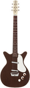 Musical Instruments:Electric Guitars, 1960's Danelectro Deluxe Walnut Solid Body Electric Guitar....