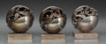 Decorative Arts, French, Three Edgar Brandt Silvered Metal Boule de Gui Paperweights.Circa 1925. Stamped EDGAR BRANDT. Ht. 3-3/4 in.. ... (Total: 3Items)