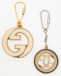 Gucci Set of Two; White Enamel & Gold Monogram Circular Keychain and Small Silver & Gold Monogram Circular Keych...