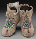 American Indian Art:Beadwork and Quillwork, A Pair of Northern Plains Beaded Hide Moccasins. c. 1890... (Total:2 Items)