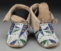 American Indian Art:Beadwork and Quillwork, A Pair of Sioux Beaded Hide Moccasins . c. 1890... (Total: 2 )