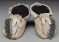 American Indian Art:Beadwork and Quillwork, A Pair of Kiowa Beaded Hide Moccasins. c. 1885... (Total: 2 )