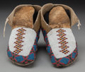American Indian Art:Beadwork and Quillwork, A Pair of Blackfoot Beaded Hide Moccasins. c. 1890... (Total: 2 )