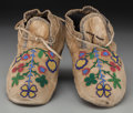 American Indian Art:Beadwork and Quillwork, A Pair of Northern Plains Beaded Hide Moccasins... (Total: 2 )