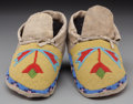 American Indian Art:Beadwork and Quillwork, A Pair of Plains Cree Beaded Hide Moccasins... (Total: 2 )