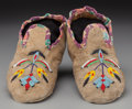 American Indian Art:Beadwork and Quillwork, A Pair of Northern Pains Beaded Hide Moccasins... (Total: 2 )