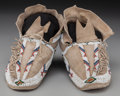 American Indian Art:Beadwork and Quillwork, A Pair of Southern Cheyenne Beaded Hide Moccasins... (Total: 2 )