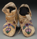 American Indian Art:Beadwork and Quillwork, A Pair of Plateau Beaded Hide Moccasins... (Total: 2 )