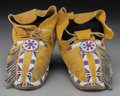 American Indian Art:Beadwork and Quillwork, A Pair of Southern Cheyenne Beaded Hide Moccasins ... (Total: 2 )