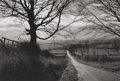 Photographs:Gelatin Silver, George A. Tice (American, b. 1938). En Route to Whitby,1990. Gelatin silver. 12 x 18 inches (30.5 x 45.7 cm). Signed in...