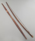 American Indian Art:Pipes, Tools, and Weapons, Two Wood Bows. c. 1880... (Total: 2 )