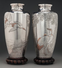 A Pair of Japanese Silver and Mixed Metal Vases with Cranes on Carved Rosewood Stands, circa 1947 Marks: (characte