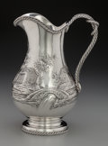 Silver Holloware, Continental:Holloware, A Continental Silver Repoussé Landscape Water Pitcher, second half19th century. Marks: (horse head), (crowned figure). 11 i...