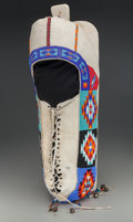 American Indian Art:Baskets, A Plateau Beaded Hide Baby Carrier...