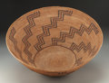 American Indian Art:Baskets, A Large Yokuts Polychrome Coiled Bowl . c. 1900...