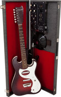 Musical Instruments:Electric Guitars, Late 1960's Silvertone 1457 Amp-in-Case Redburst Solid BodyElectric Guitar....