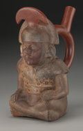 Pre-Columbian:Ceramics, Moche Stirrup Bottle with Seated Dignitary. c. 200 - 400 AD. ...
