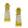 Estate Jewelry:Earrings, Diamond, Gold Earrings. Each elongated hoop features full-cutdiamonds, pave set in corrugated 18k yellow gold. Total diam...(Total: 2 Pieces)