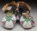 American Indian Art:Beadwork and Quillwork, A Pair of Sioux Beaded Hide Ceremonial Moccasins. c. 1890...(Total: 2 )