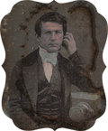 Photographs, Unknown (American, 19th Century). Portrait of a photographer with a chamfered box daguerreotype camera, circa 1850. Sixt...
