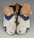 American Indian Art:Beadwork and Quillwork, A Pair of Sioux Beaded Hide Ceremonial Moccasins. ... (Total: 2 )