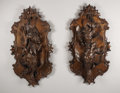"Paintings, A Pair of Large Wooden ""Black Forest"" Style Carved Plaques in the Form of Pheasants and Other Game. Unknown maker, Germany... (Total: 2 Items)"