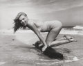 Photographs, Andre de Dienes (American, 1913-1985). Marilyn on the Beach, 1949. Gelatin silver, 1992. 11 x 14 inches (27.9 x 35.6 cm)...
