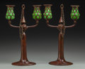Art Glass:Tiffany , Pair of Tiffany Bronze and Green Favrile Glass Two-LightCandelabra. With original bobeche and snuffers.. Circa 1900.Stampe... (Total: 2 Items)