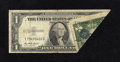 Error Notes:Foldovers, Fr. 1614 $1 1935E Silver Certificate. Very Good.. It is simplyamazing that a major error such as this foldover would be use...
