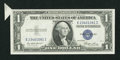 Error Notes:Attached Tabs, Fr. 1614 $1 1935E Silver Certificate. Choice About Uncirculated.....