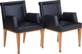 Furniture : American, A Pair of Art Deco Black Leather and Maple Armchairs, 20th century.33 inches high x 24 inches wide x 22 inches deep (83.8 x... (Total:2 Items)