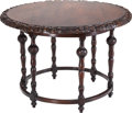 Furniture , An English Colonial-Style Carved Mahogany Center Table,. 31 inches high x 48 inches diameter (78.7 x 121.9 cm). ...