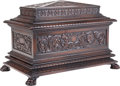 Furniture : Continental, A Continental Carved Walnut Sarcophagus Cellarette, 19th century.19 inches high x 29 inches wide x 17-1/2 inches deep (48.3...
