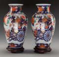Asian:Japanese, A Pair of Japanese Imari Porcelain Vases with Mahogany Stands, 20thcentury. 12 inches high (30.5 cm) (without stand). PRO... (Total: 4Items)