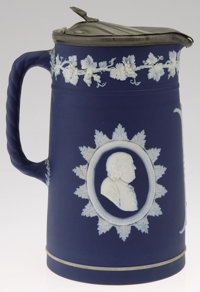 A PORCELAIN PITCHER Wedgwood, c.1890  The cobalt blue bisque ground with ivory pate-sur-pate floral design with Benjamin...