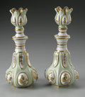 Decorative Arts, French:Other , A PAIR OF FRENCH PORCELAIN PERFUME BOTTLES. Makers unknown, French.The matching pair of porcelain bottles with stoppers, ... (Total: 4Items)