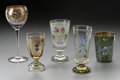 Art Glass:Other , FIVE ENAMEL DECORATED GLASSES. Various makers, c.1890. Comprising acushion footed stemmed cylindrical tumbler decorated w... (Total: 5Items)