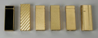 A GROUPING OF SIX LIGHTERS Alfred Dunhill of London, Inc.  The group of six gold plated lighters with textured surfaces...