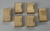 A GROUPING OF SIX FRENCH LIGHTERS St. Dupont, France  The group of six gold lighters with textured surfaces, all marked...