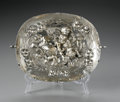 Other:European, A SILVER PLATE. Maker unknown, possibly German. The small servingplate with repousse design with cherubs, C-scroll handle...