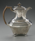 Other:European, AN ENGLISH SILVER TEAPOT. Hallmarked JS &S, Sheffield, England,c.1864. The teapot with wooden finial and wooden handle, e...